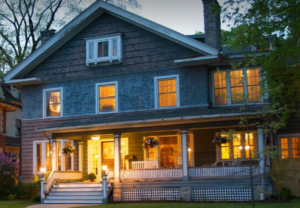 Historic home B&B at dusk with lights on