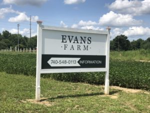 white directional sign for the Evans Farm neighborhood in Lewis Center Ohio
